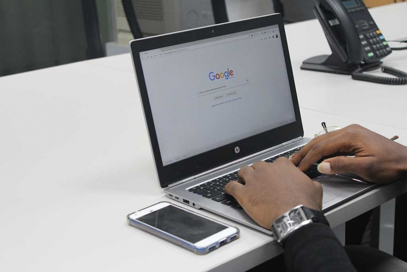 doing a google search on a laptop